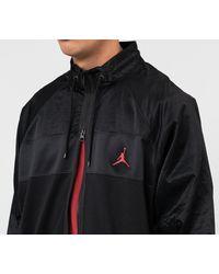 Wings Suit Jacket Black/ Black/ Black/ Gym Red di Nike da Uomo