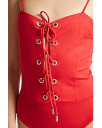 Forever 21 - Red Lace-up Grommet Cami Bodysuit - Lyst