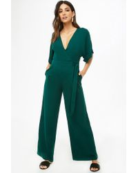 7cc1e253ce9 Forever 21 Surplice Wide-leg Jumpsuit in Green - Lyst
