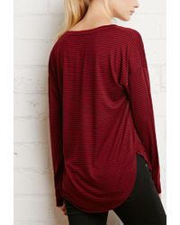 Forever 21 - Red Striped Dolphin Hem Top - Lyst