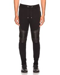 Balmain - Black Ribbed Moto Sweatpants With Leather Details - Lyst