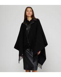 Poncho ample zippé bi matière The Kooples en coloris Black