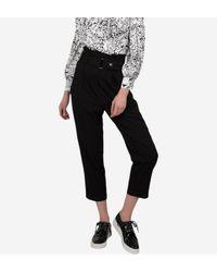 Pantalon paper bag 7/8ème noir Molly Bracken en coloris Black