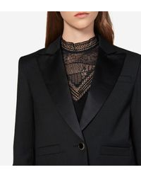 Veste courte noire Sandro en coloris Black