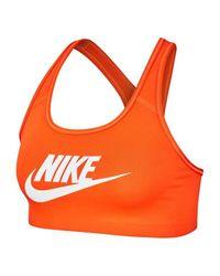 Brassière Swoosh Futura Nike en coloris Orange