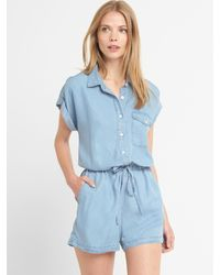 abb70d084629 Gap Tenceltm Denim Roll-sleeve Romper in Blue - Lyst