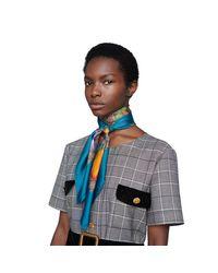 Pañuelo de seda con GG y estampado Flora Gucci de color Natural
