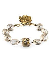 Bracelet en perles avec détail fleuri Gucci en coloris Metallic