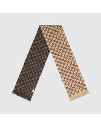 Gucci Natural Schal aus Wolle mit GG Motiv