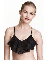cb6e6a5ed1 H&M Frilled Bikini Top in Black - Lyst