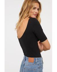 H&M - Black Short-sleeved Jersey Bodysuit - Lyst