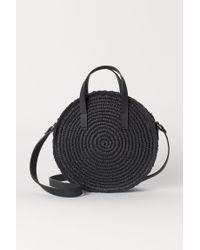 H&M Black Runde Papierstroh-Handtasche