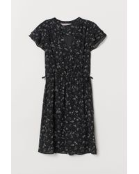 H&M Black Kleid mit V-Ausschnitt