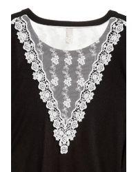 H&M Black Pullover mit Spitzendetails