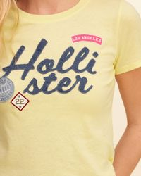 Hollister - Yellow Patch Logo Graphic Tee - Lyst