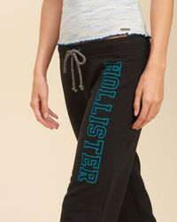 Hollister - Black Skinny Logo Graphic Sweatpants - Lyst
