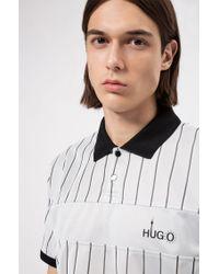 Polo Regular Fit orné d'un motif artistique inspiré de Berlin HUGO pour homme en coloris Multicolor