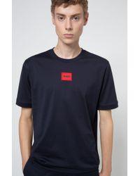 T-shirt en jersey de coton à col rond, avec badge logo HUGO pour homme en coloris Blue