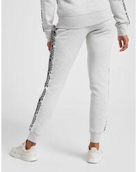 Pantalon de Survêtement Polaire Tape Femme adidas Originals ...