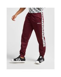 Adidas Originals Red Tape Poly Track Pants for men