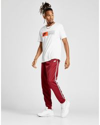 fondo repentinamente Diplomacia  Nike Synthetic Gel Tape Cuffed Track Pants in Red for Men - Lyst