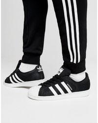Adidas Originals Black Superstar Cuffed Track Pants for men