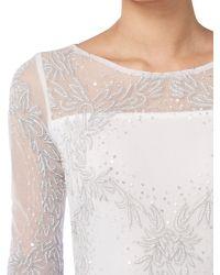 Raishma White Full Sleeve Embellished Bridal Gown