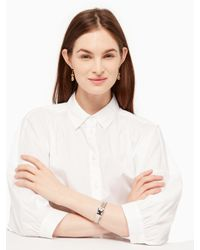 kate spade new york - Metallic A Notch Above Hinged Buckle Bangle - Lyst