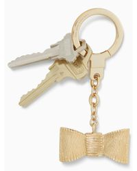 Kate Spade - Metallic All Wrapped Up Bow Keychain - Lyst