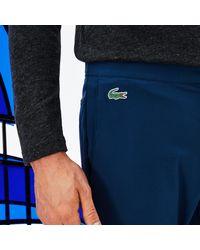 Lacoste Blue Sport Novak Djokovic Stretch Technical Midlayer Trackpants for men