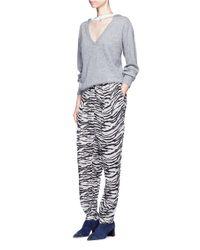 Toga - Black Leopard Print Pleated Drawstring Pants - Lyst