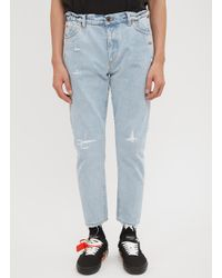 5b3879a54aa Lyst - Off-White c o Virgil Abloh White Washed Tapered Jeans In Blue ...