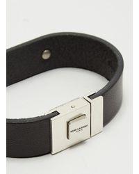 Saint Laurent Logo Plaque Leather Bracelet In Black for men