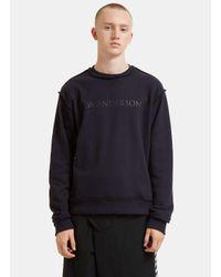 J.W. Anderson - Blue Logo Branded Overlocked Sweater In Navy for Men - Lyst
