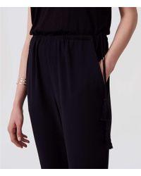LOFT Black Petite Tasseled Mixed Media Jumpsuit