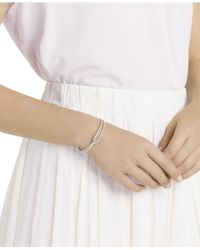 Swarovski - Metallic Rose Gold-tone Crystal Knot Bangle Bracelet - Lyst