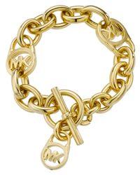 Michael Kors | Metallic Rose Gold-tone Logo Lock Toggle Bracelet | Lyst