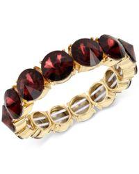 Kenneth Cole | Metallic Gold-tone Burgundy Stone Stretch Bracelet | Lyst
