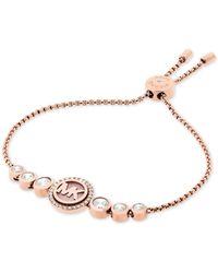 Michael Kors | Metallic Rose Gold-tone Crystal Logo Slider Bracelet | Lyst