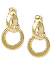 Anne Klein Metallic Earrings, Silver-tone Twisted Hoop Clip On Earrings