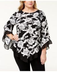 738ad56697a Women s Black Plus Size Ruffled Pointed-hem Top ...