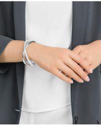 Swarovski - Metallic Silver-tone Crystal Dust Crossed Cuff Bracelet - Lyst