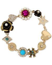 Betsey Johnson - Metallic Gold-tone Multi-charm Link Bracelet - Lyst