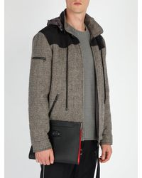 Pochette en cuir ornée de clous Skypouch Loubicity Christian Louboutin pour homme en coloris Black