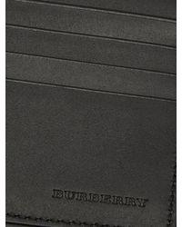 Portefeuille en cuir grainé à deux volets Burberry pour homme en coloris Black