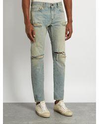 Saint Laurent Blue Distressed Skinny Jeans for men