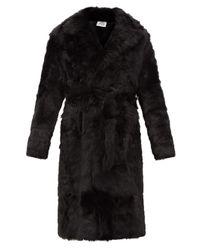 Manteau en shearling ceinturé Vetements en coloris Black