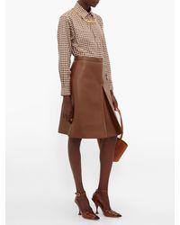 Jupe en similicuir à plis inversés Burberry en coloris Brown