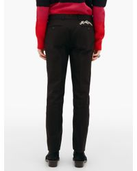 Pantalon ajusté en coton à broderie logo Alexander McQueen pour homme en coloris Black