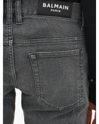 Jean slim biker effet vieilli Balmain pour homme en coloris Gray